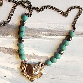 122H-013 Bronze pendant litlle Owl +  turquoiseteinted  howlite and pyrit beads