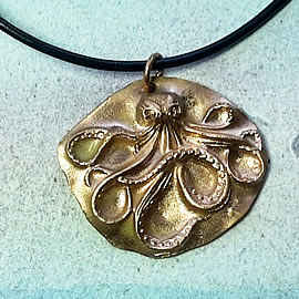 -42V1-003 Pendant:  bronze octopus,   on a black leather band