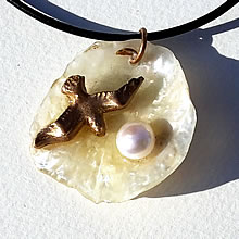 342G0-110 Pendant Handmade bronze seagull, sweetwater pearl on an iridescent  anomia shell