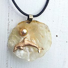 442U0-012 Pendant: Bronze Dolphin  on a beautiful transluscent anomia shell+sweetwater pea