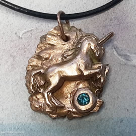64203-018 Bronze pendant, meteorite,unicorn +blue Czirconia, black leather