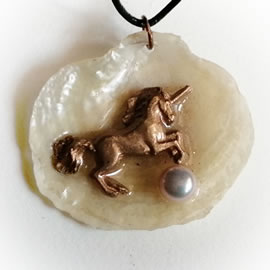 642O5-117 Pendant-handmade goldbronze unicorn, sweetwater pearl on an iridescent anomia sh
