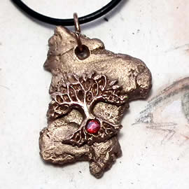 a42a6-048 Bronze pendant, meteorite- Yggdrasil the celtic tree of life +red zirconia