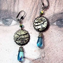 b6fm-013 Earrings with filigree, watch mecanism & blue  crystal drop