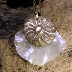 e42t-015 Pendant handmade Bronze piece on a white  anomia shell