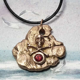 f42qz-039 Bronze pendant, meteorite-gothique  - pirate skull - , red zirconium