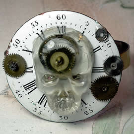 f720-002 ajustable Steampunk-Gothic bracelet, dial, skull head in resin with cogs inclusio