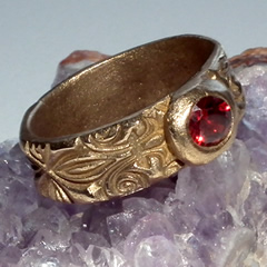 z92a-023 Several sizes Unisex bronze rings , medieval style with a red zirconia