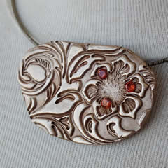 n22A-017 Bronze neckllace, flower  and 3 orange  zirconias