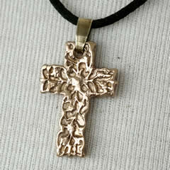 o42C-003 little bronze cross - pendant on a black leather strap