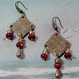 j62a-009 Bronze earrings celtic  knot  with bronze and   treated ruby beads