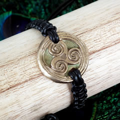 y72b-010 Bracelet triskelion in golden bronze +black macrame leather
