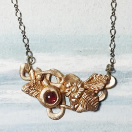 n22A-007 Elven necklace in gold bronze decorated with flowers and leaves
