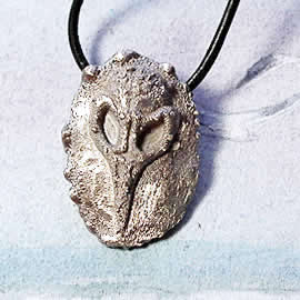 021K-012  Gothic pendant , raven skull in white bronze on a black leather