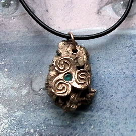 y42az-003 Bronze pendant, bronze meteorit + celtic Triskelion and an aqua blue  zirconia