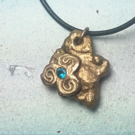 y42az-025 Bronze pendant, bronze meteorit + celtic Triskelion and an aqua blue  zirconia