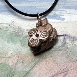 y42bz-002 Bronze pendant,   bronze meteorit with a  celtic Triskelion  on a black leather