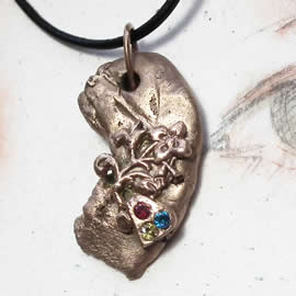n42Az-029 Bronze pendant, meteorite-  flowers, red, blue and yellow zirconias  black leath