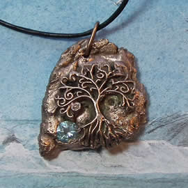 a42a9-021 Bronze pendant, meteorite- Yggdrasil the celtic tree of life+pale blue zirconia