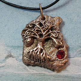 a42a9-030 Bronze pendant, meteorite- Yggdrasil the celtic tree of life +red zirconia